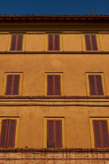 Architecture of Perugia Historical Building Historic Colorful Vivid Architectural Lines Lines No People Outdoors Low Angle View Window Façade Built Structure Blue Sky Renaissance Architecture Architecture Building Exterior Umbria Italy Perugia Urban Scenery Shutters Looking Up