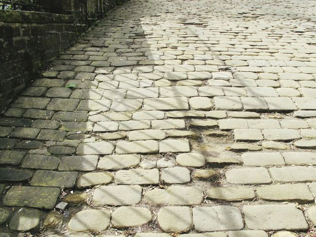 Uphill Cobbles Cobblestone Hill Stone Stones Hovis Hovishill Haworth Bronte Sisters Bronte Yorkshire West Yorkshire Showcase April Walking Around Walking Light And Shadow Shadow Fence Path Road The KIOMI Collection Tourist Attraction  Outdoors Outdoor Photography