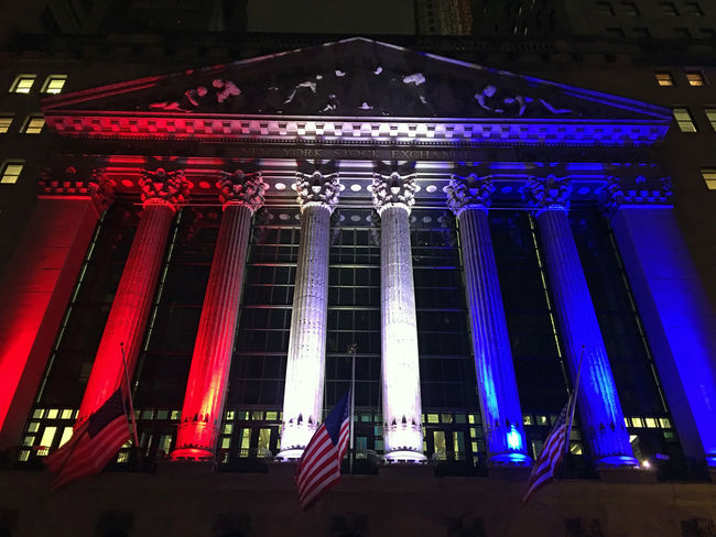 The New York Stock Exchange building on Wall Street, by night. Architecture Blue Built Structure City City Life Financial District  Illuminated Investing Low Angle View Manhattan Modern Money Multi Colored New York City New York Stock Exchange  Night Nightphotography No People NYC Outdoors Sky Stocks Wall Street
