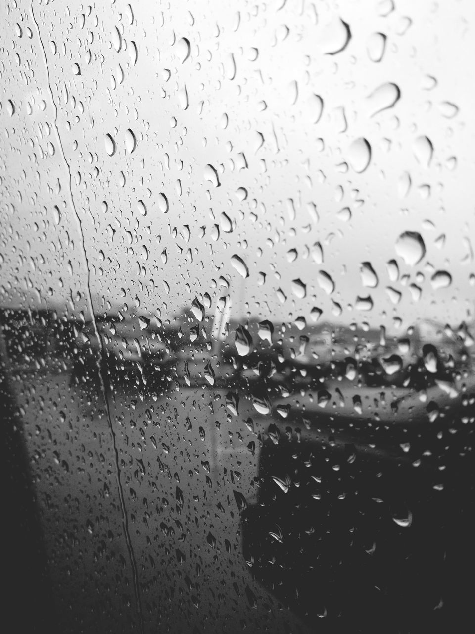drop, transparent, glass - material, water, wet, window, rain, indoors, raindrop, full frame, backgrounds, weather, no people, rainy season, close-up, day, nature, sky, freshness