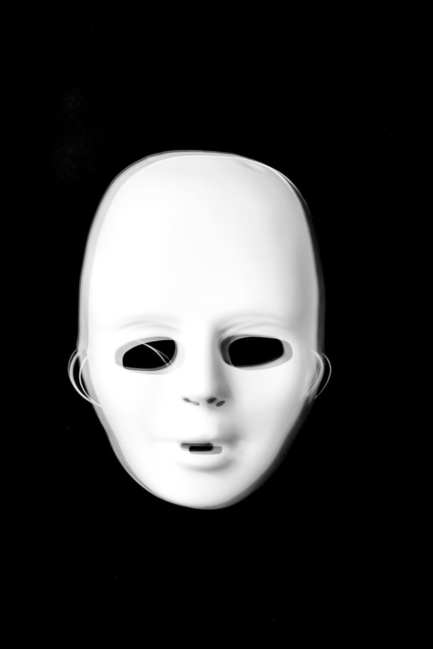 human representation, black background, doll, close-up, no people, indoors, disguise, day