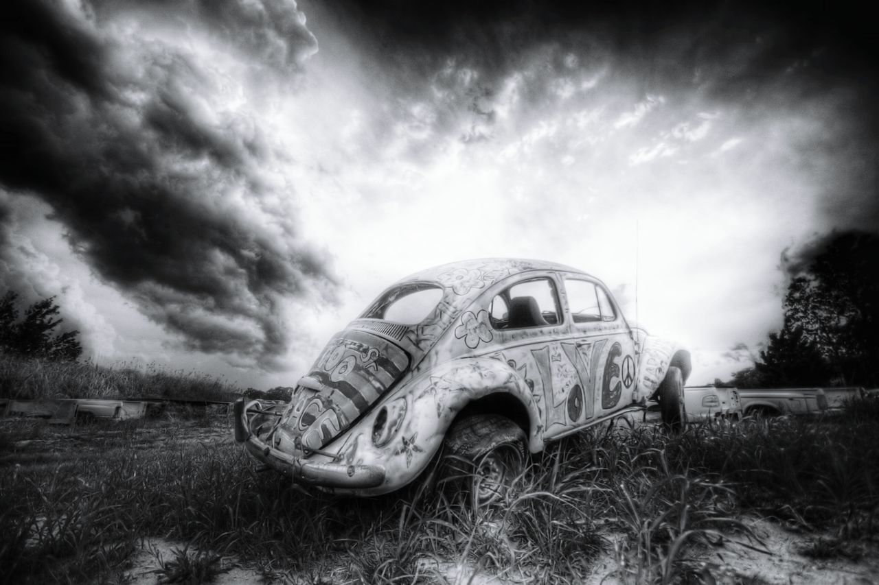Cloud - Sky Car Sky Obsolete Damaged No People Landscape Grass Field Outdoors Cloudscape Bad Condition Storm Cloud Day Nature This Week On Eyeem Texas Photographer Eyeemphotography Nature Low Angle View Power In Nature Dramatic Sky EyeEm Gallery Black And White Collection!