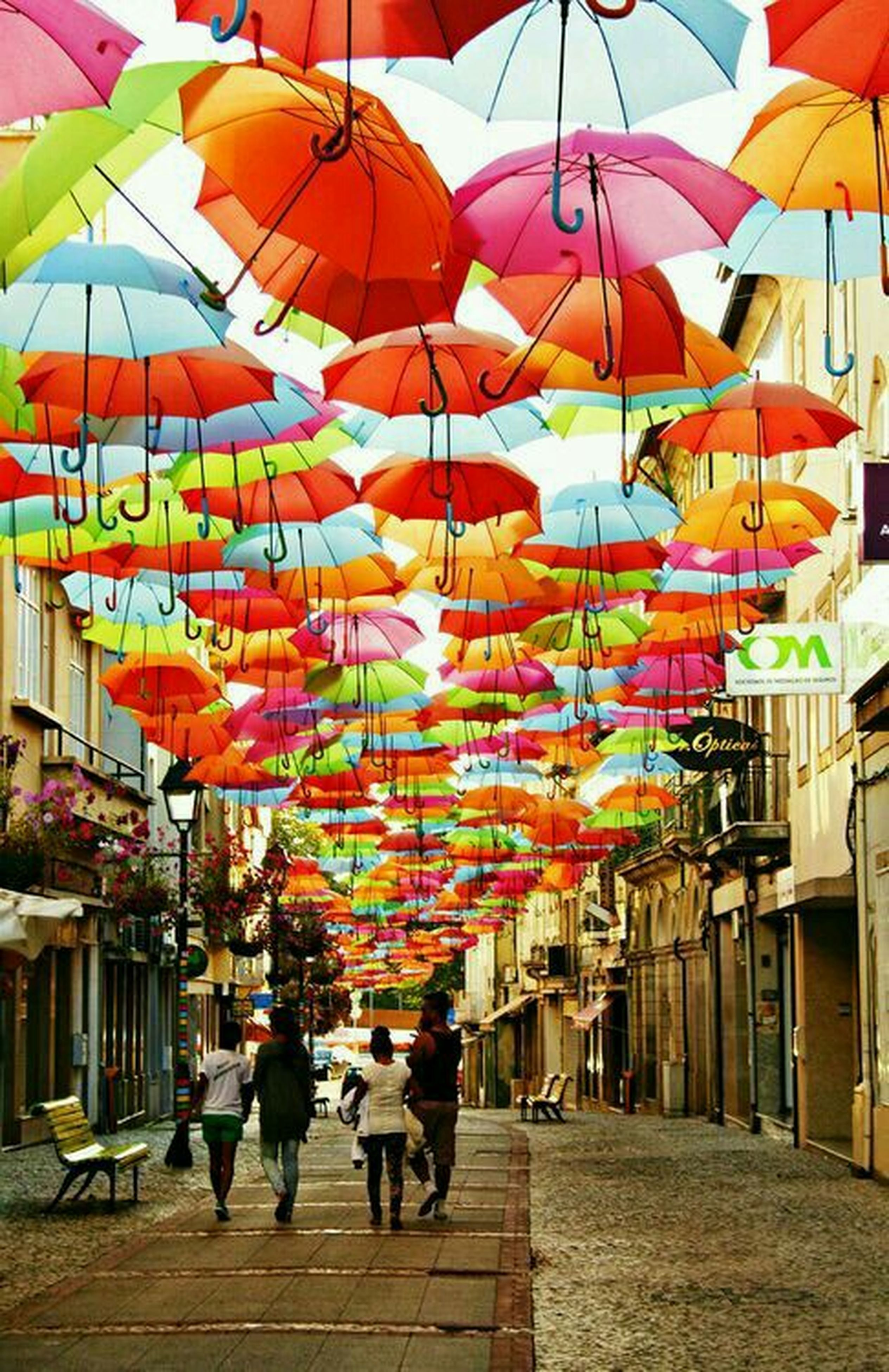 large group of people, multi colored, men, person, umbrella, lifestyles, leisure activity, celebration, architecture, building exterior, traditional festival, built structure, cultures, decoration, tradition, walking, hanging, balloon, colorful