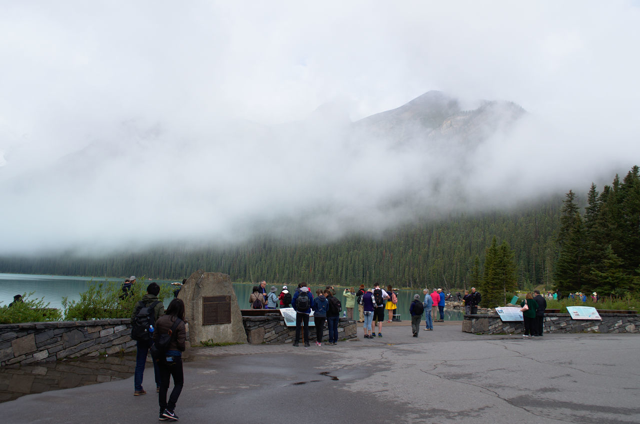 real people, mountain, large group of people, smoke - physical structure, physical geography, sky, nature, leisure activity, outdoors, day, men, lifestyles, geyser, landscape, travel destinations, scenics, adventure, hot spring, mountain range, women, beauty in nature, people