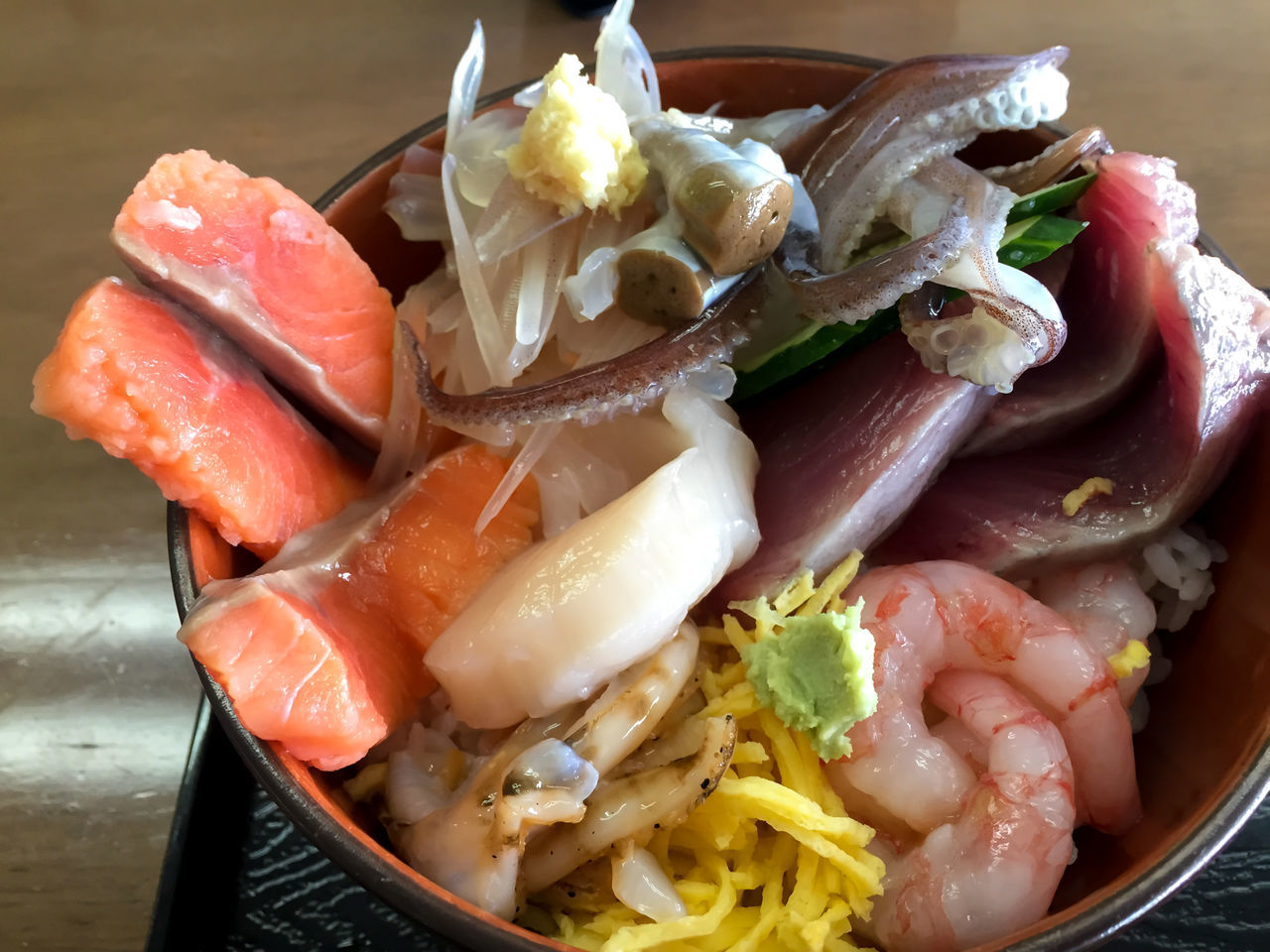 A bowl of fresh sashimi - squid, salmon, tuna and shrimp. Close-up Day Fish Food Food And Drink Freshness Healthy Eating High Angle View Indoors  No People Plate Ready-to-eat Salmon Sashimi  Sashimi  Seafood Serving Size Shrimp Squid Tuna
