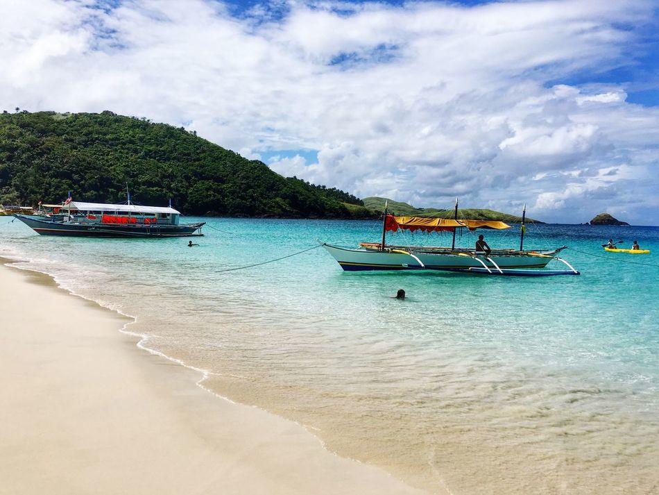 Life's a beach. RrPhotos Calaguas, Philippines Itsmorefuninthephilippines Philippines Calaguas Beachlife Summer White Sand Beach Boat Sand Sun Sea EyeEm Best Shots