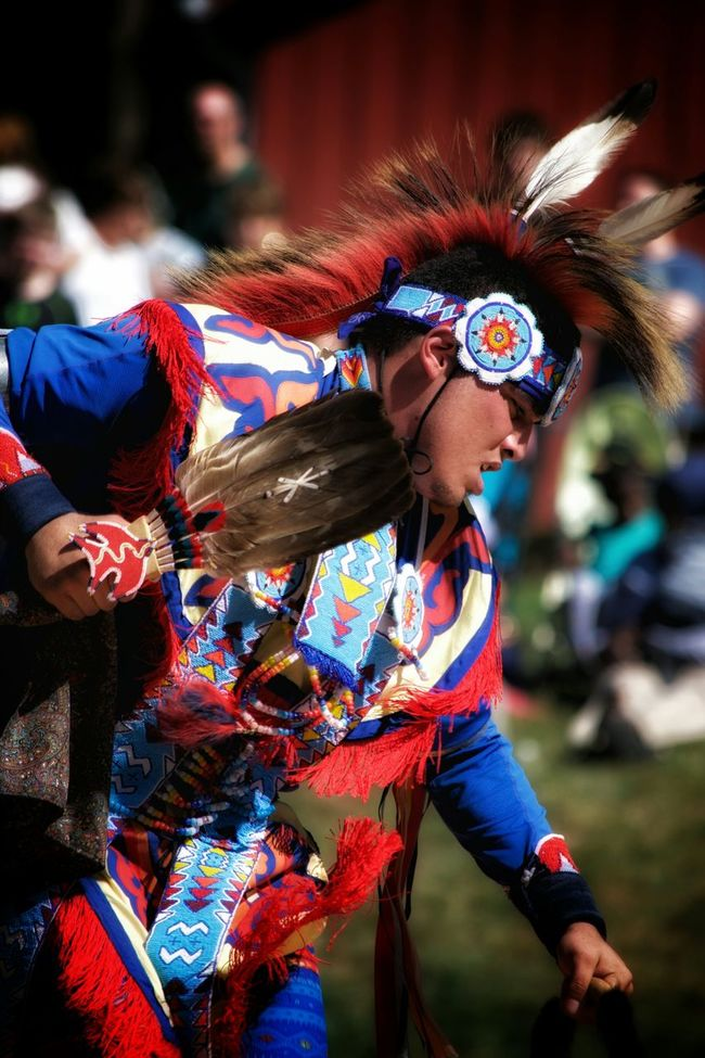 A Native American dancer performs a warrior dance at a local festival. Capture The Moment Native American Native Dancer Storytelling Dancer Festival Bright Colors Nativebeauty  Dance Warrior