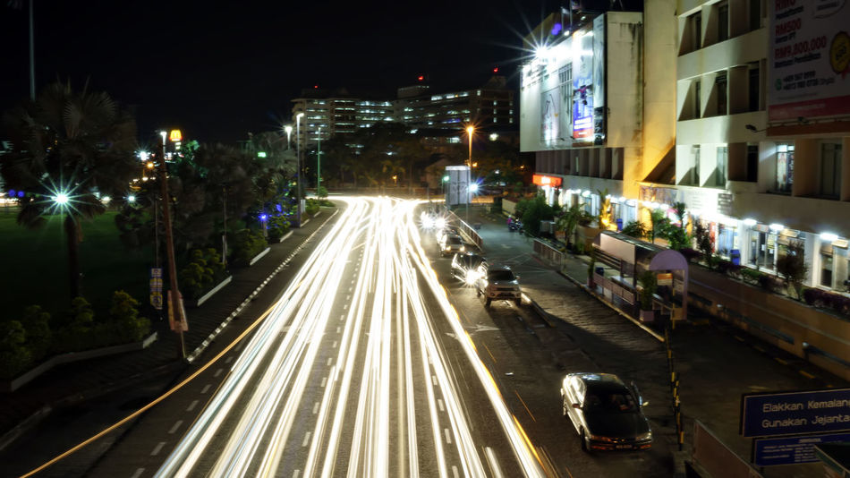 NETSCAPE LIGHT TRILL Architecture Blurred Motion Building Exterior Built Structure City High Street Illuminated Light Trail Long Exposure Motion Night No People Outdoors Road Speed Street Transportation