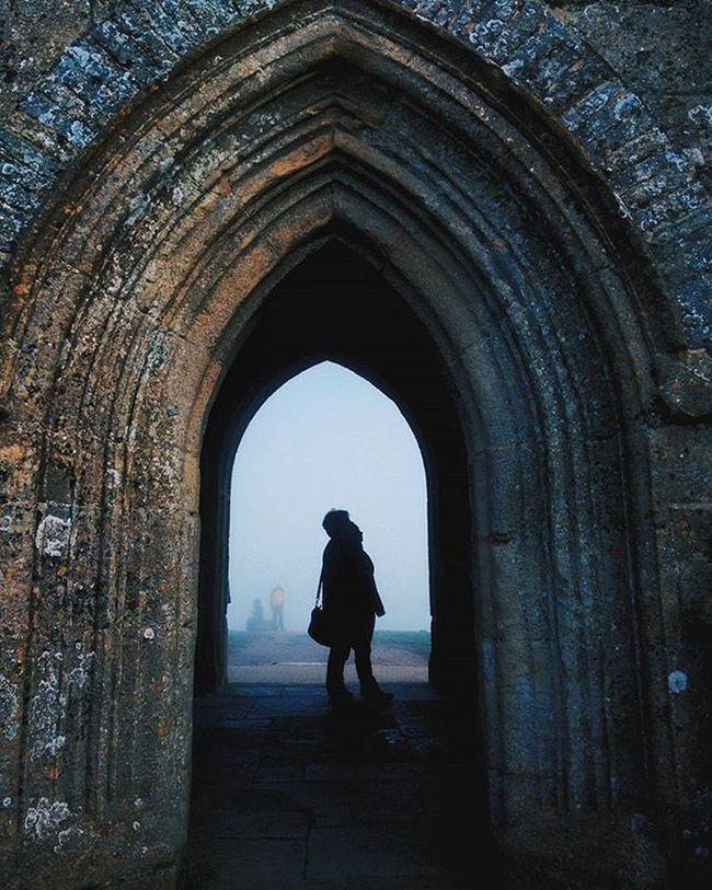 Silhouettes through the mist at the Tor, one of the many locations of the Holy Grail Travel Glastonbury Arthurianlegend Faeries  Holygrail Galahad Silhouette Isleofavalon Mystical Mythology Medieval Arches Architecture Archilovers Candid VSCO Vscocam Vscomood Justgoshoot ExploreEverything Exploretocreate England Uk Kingarthur MERLIN galahad pixelpanda