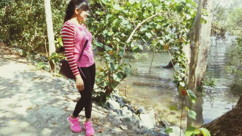 Full Length Water One Person Day Real People Casual Clothing Outdoors Nature Young Women Young Adult
