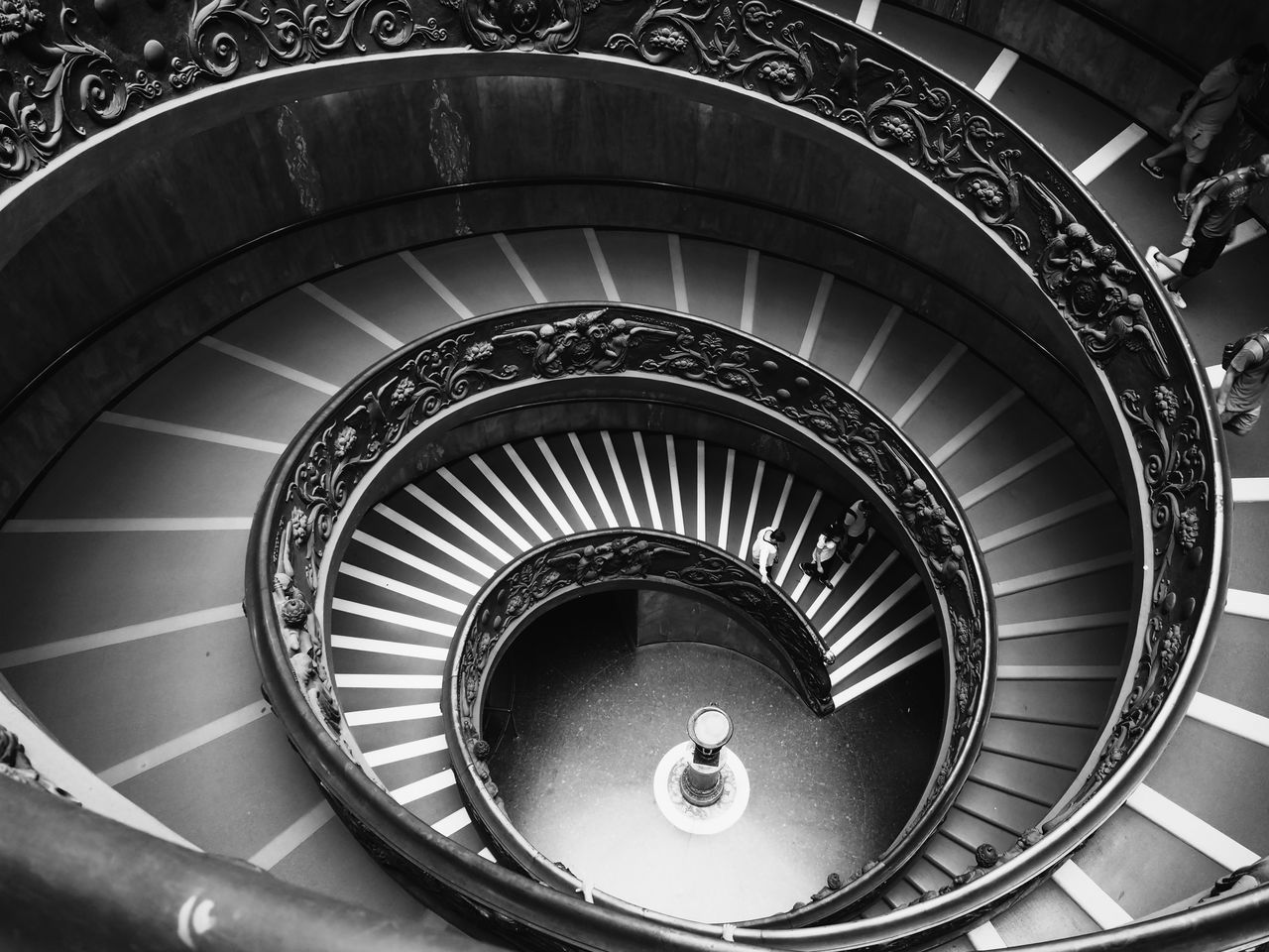 staircase, steps and staircases, spiral, architecture, steps, railing, built structure, spiral stairs, stairs, high angle view, hand rail, one person, day, indoors, people