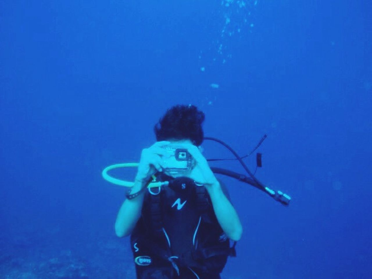 underwater, undersea, scuba diving, adventure, sea, one person, people, adults only, adult, one woman only, exploration, scuba mask, swimming, looking at camera, blue, only women, portrait, sea life, vacations, day, nature, one young woman only, young adult, outdoors