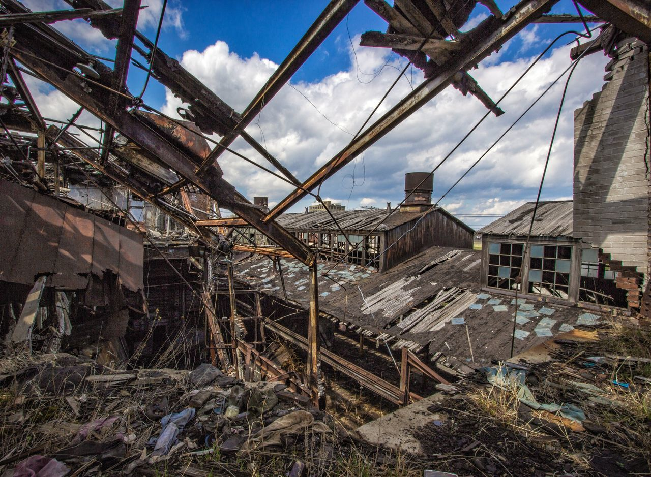 Industrial Waste Destruction Damaged Abandoned House Built Structure Residential Building Architecture Wood - Material Cloud - Sky Sky Building Exterior Bad Condition Rubble No People Outdoors Day