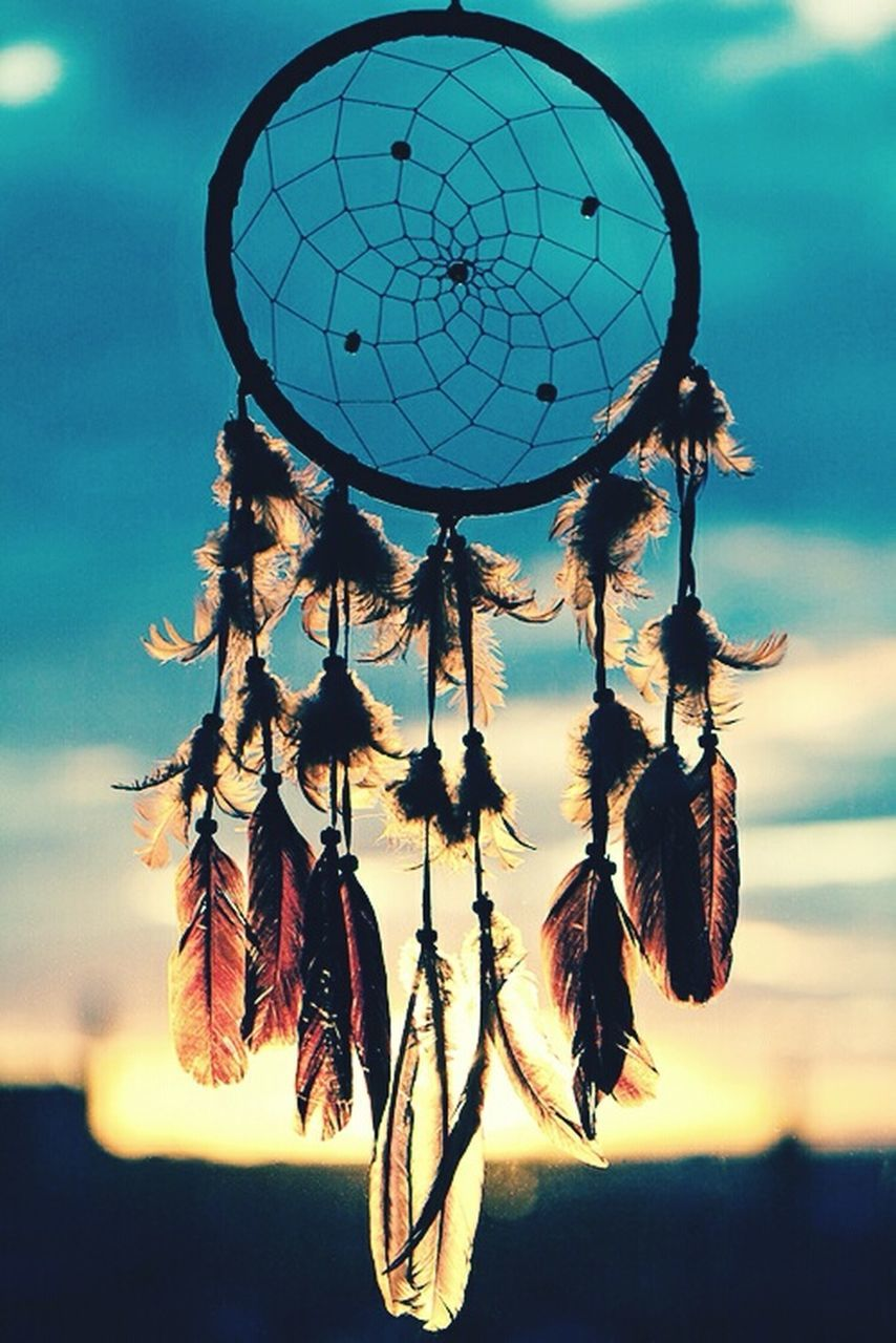 dreamcatcher, hanging, feather, no people, spirituality, outdoors, close-up, luck, day, hope, sky