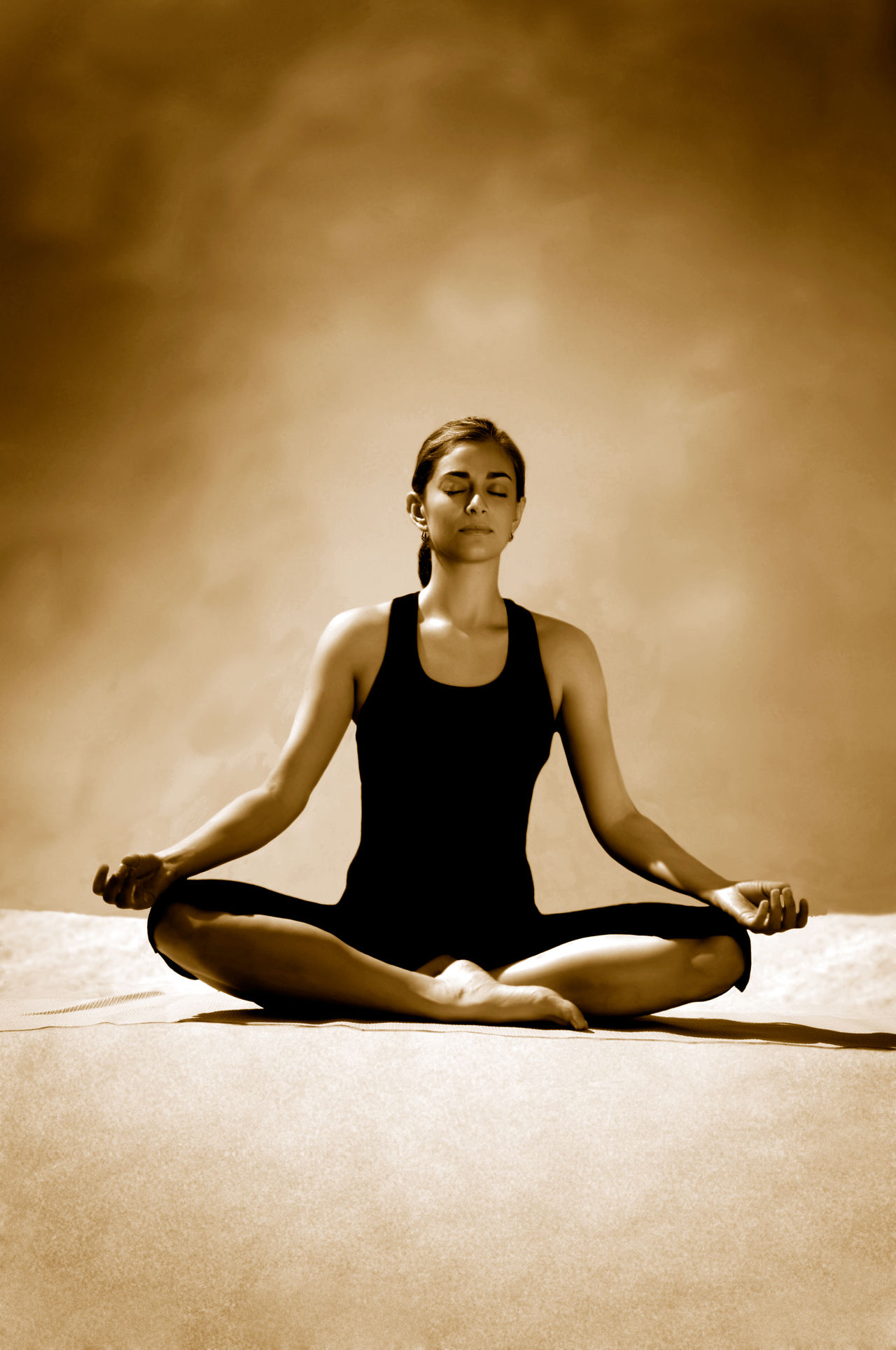 Yoga instructor meditating, sepia toned Cross-legged Healthy Lifestyle Meditating One Woman Only Relaxation Exercise Serene People Spirituality Wellbeing Women Yoga Zen-like