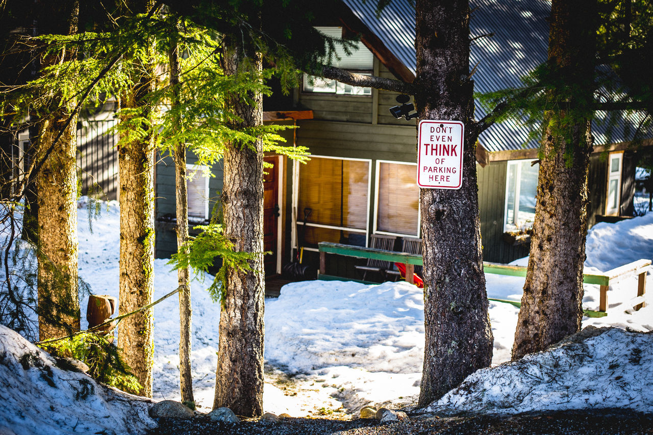 Architecture Building Exterior Built Structure Canada Car Park Cold Temperature Day Driveway Funny Sign Home Nature No Parking No Parking Sign No People Outdoors Parking Residential Building Road Sign Snow Tree Whistler Whistlerblackcomb Winter