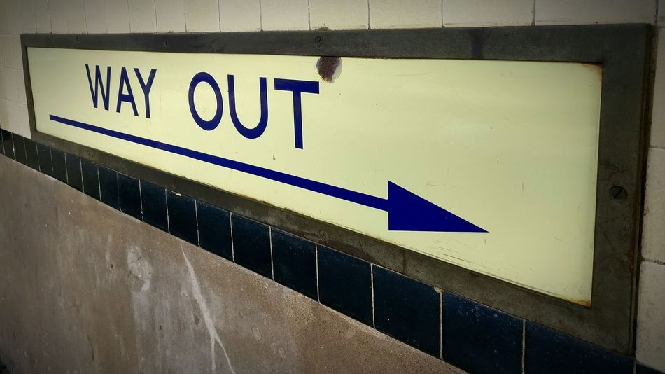 Pivotal Ideas Way Out Signal Sign Exit Arrow Pointing Right Old Sign Right Letters Western Script Way Out Sign Follow The Signs Showing The Way Underground Signs Blue Letters Blue Yellow No People Architectural Detail English Brexit