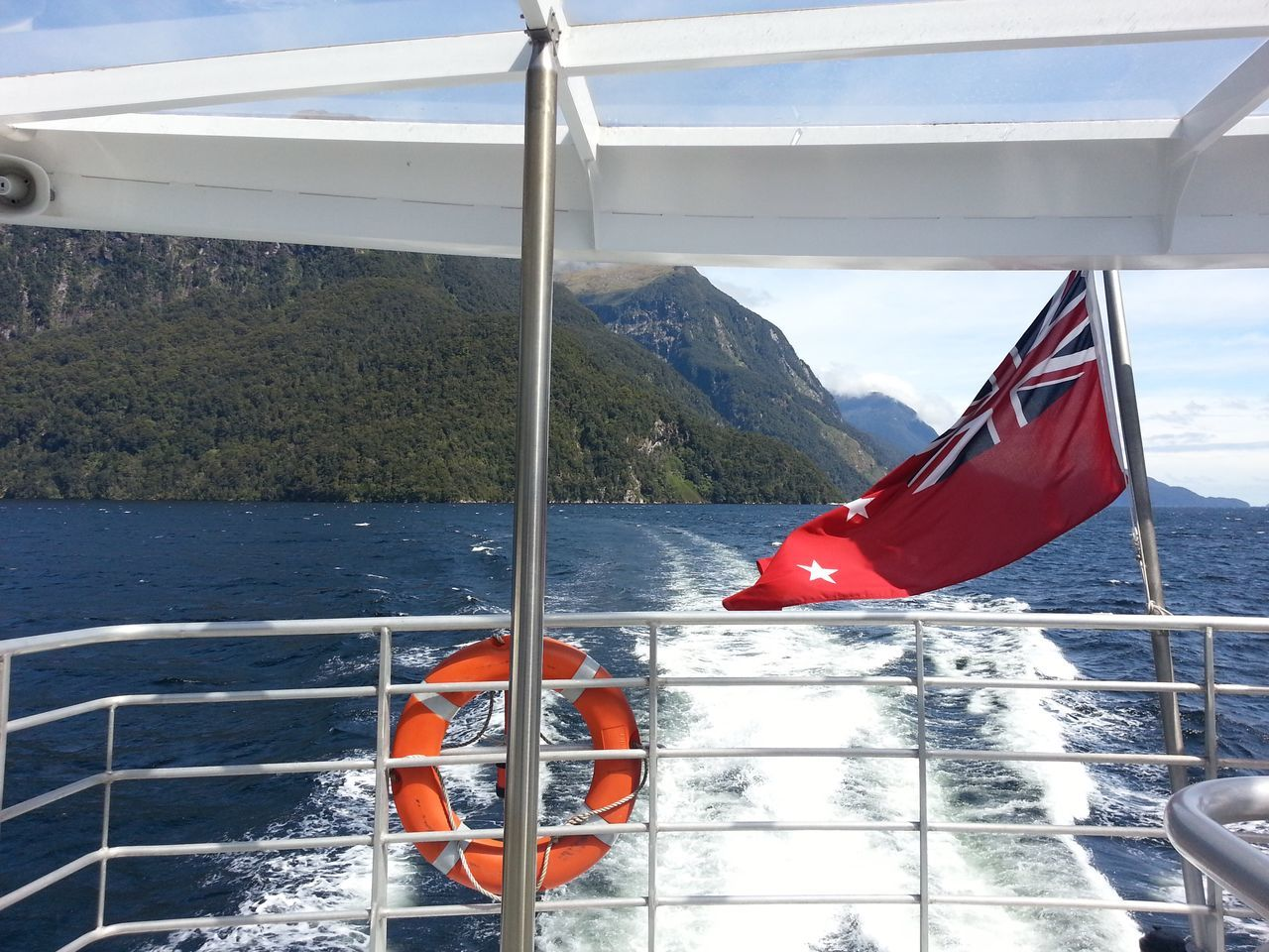 Cruising... Miles Away Boat Boattrip Doubtful Sound New Zealand Flag Water Mountains Nature Scenery