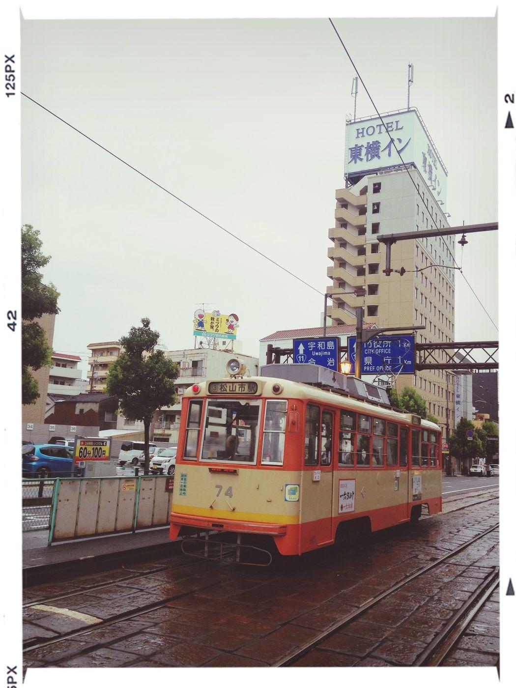 松山市内。雨は上がりました。 Train At The Station After The Rain