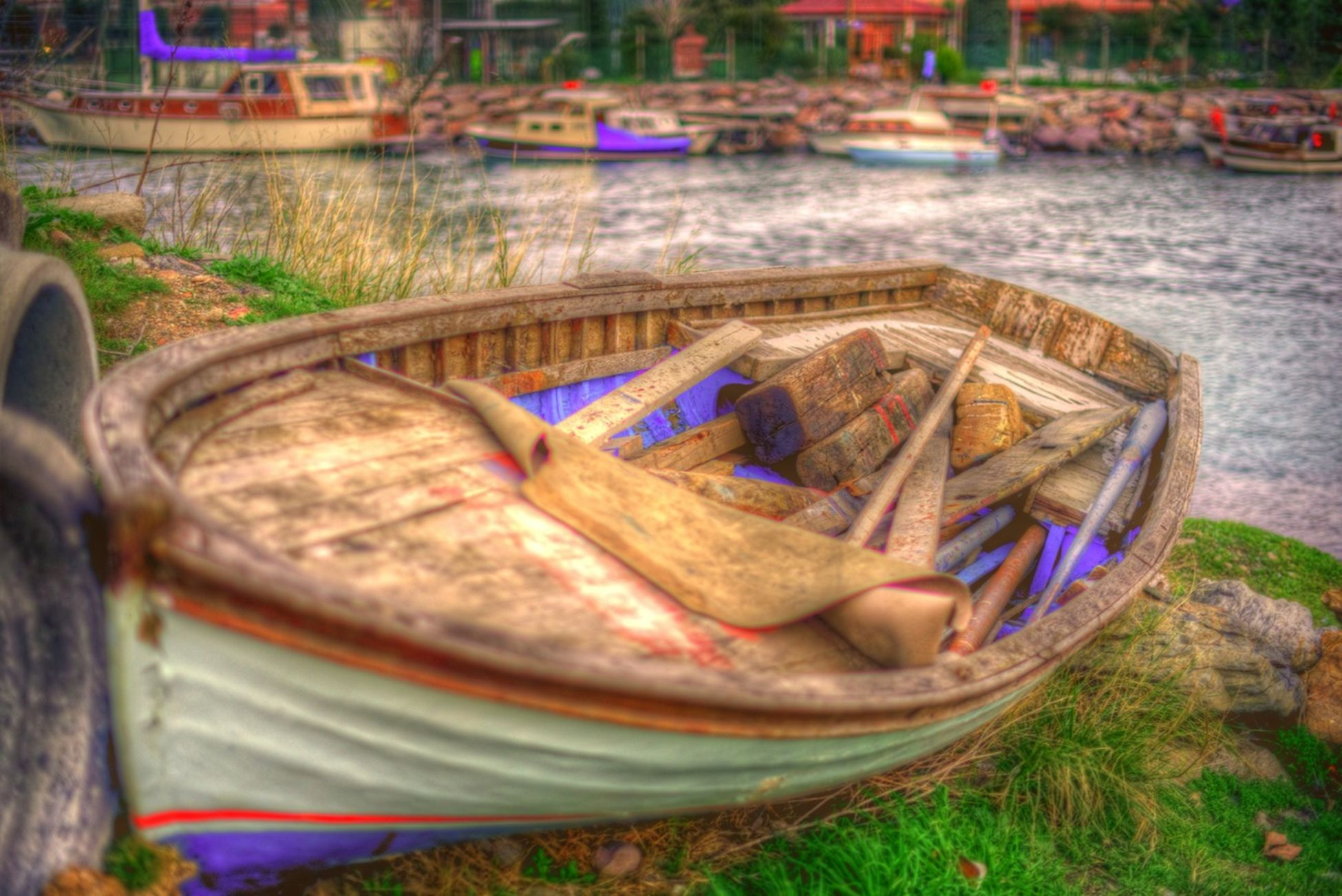water, nautical vessel, transportation, mode of transport, boat, moored, river, lake, outdoors, day, reflection, land vehicle, car, nature, riverbank, blue, incidental people, focus on foreground, no people, high angle view