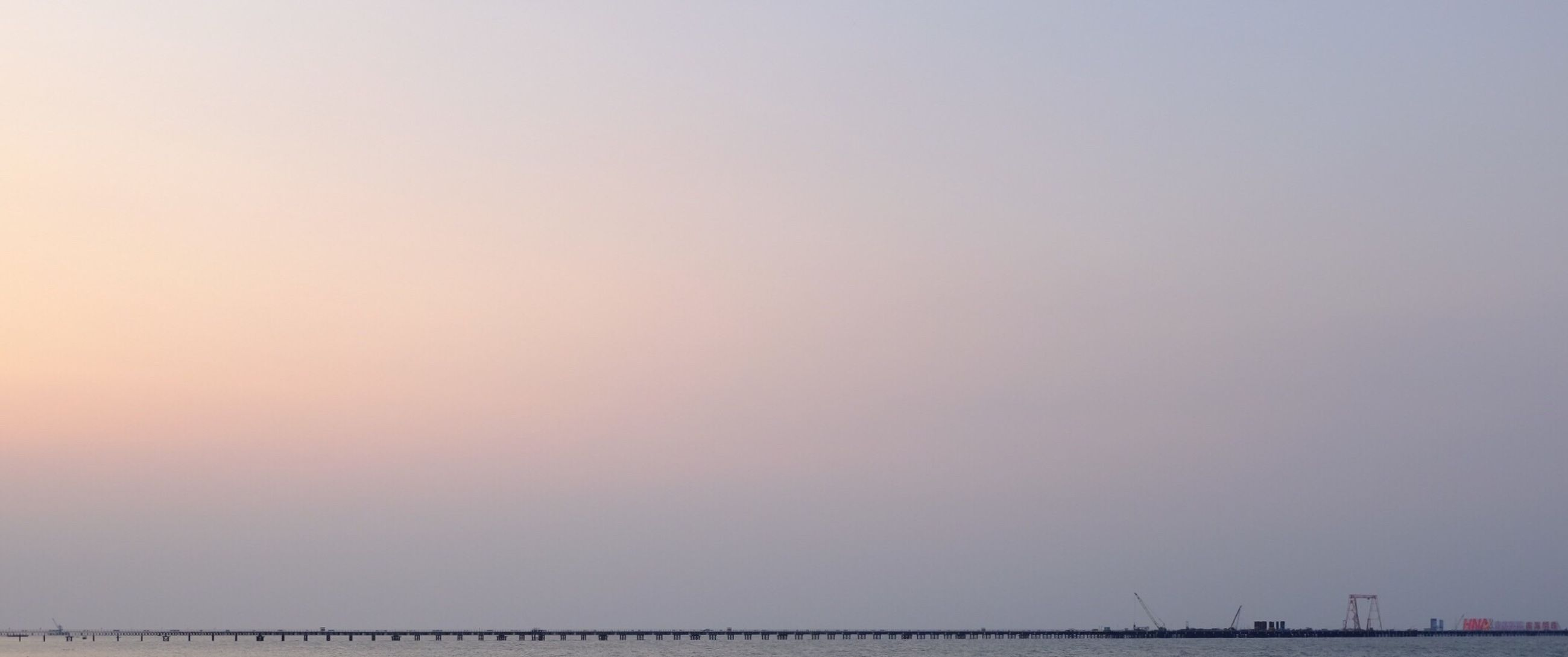 copy space, clear sky, tranquil scene, tranquility, sea, scenics, beauty in nature, nature, horizon over water, water, idyllic, sky, outdoors, no people, sunset, waterfront, foggy, remote, day