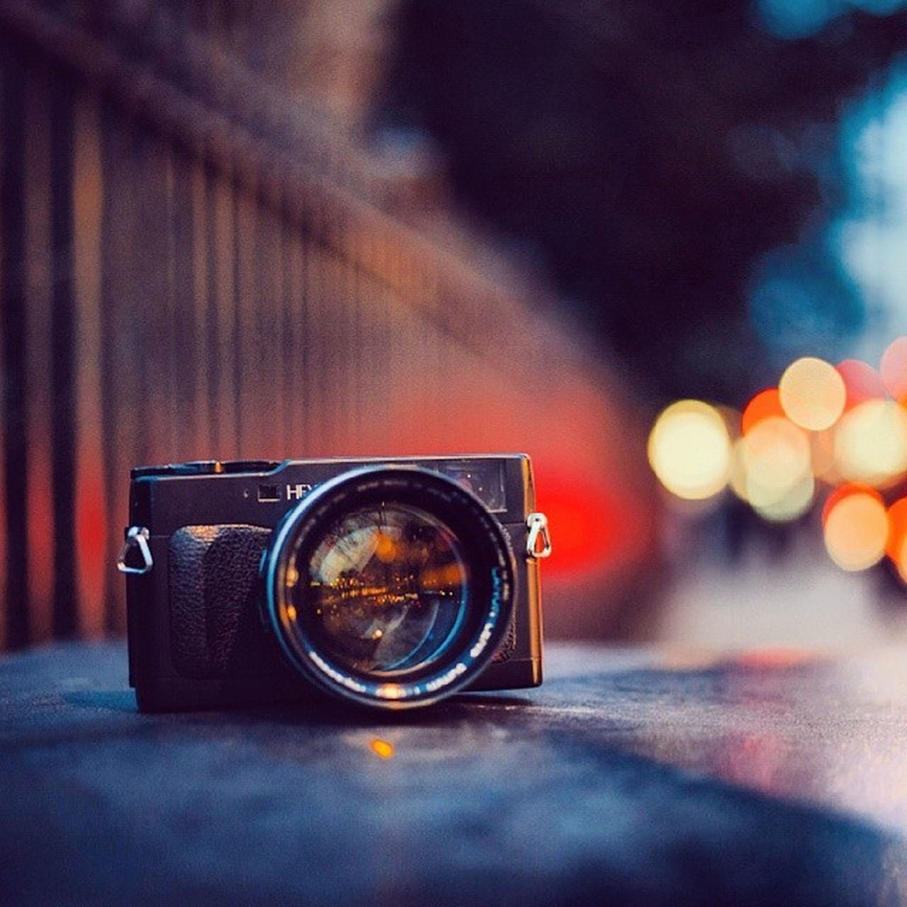 photography themes, camera - photographic equipment, technology, photographing, single object, close-up, focus on foreground, selective focus, table, retro styled, camera, digital camera, old-fashioned, no people, indoors, illuminated, modern, slr camera, digital single-lens reflex camera, day
