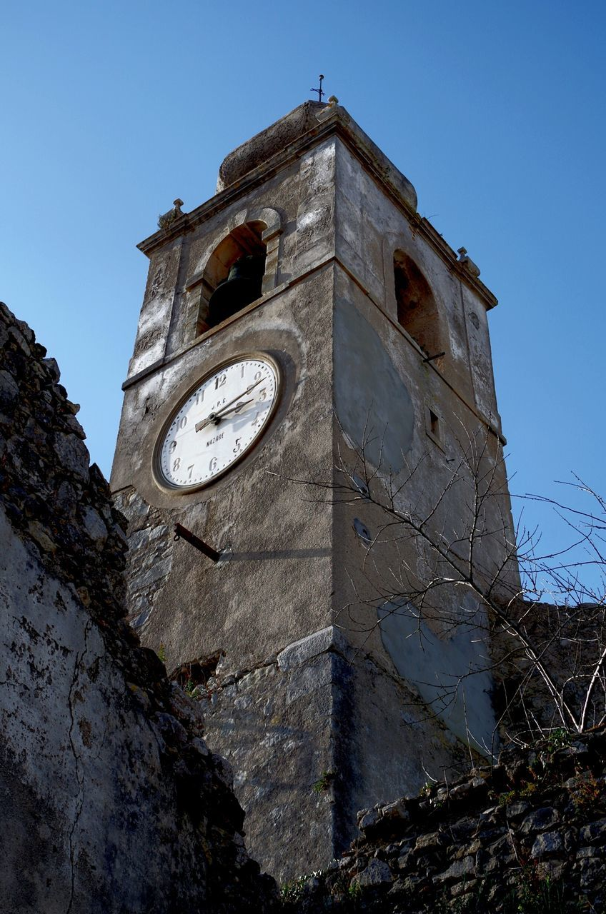 low angle view, no people, day, built structure, sky, clock, architecture, clock tower, outdoors, building exterior, time, clear sky