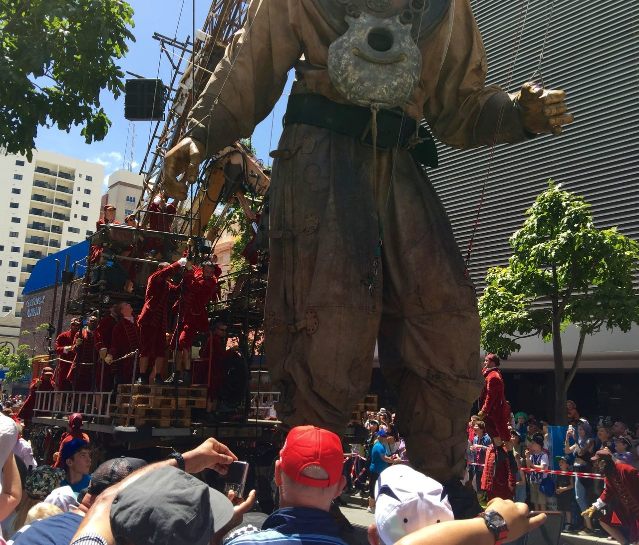PERTH, AUSTRALIA-FEBRUARY 14, 2015: Journey of the Giants, Giant Marionette Diver and Puppeteers, public International Arts Festival Art Art Event Australia Australianshepherd Belts And Pulleys City Cityscape Crane Crowds Culture Diver Festival Giant Human International Journey Marionette People Puppeteers Walking Winchester Wooden