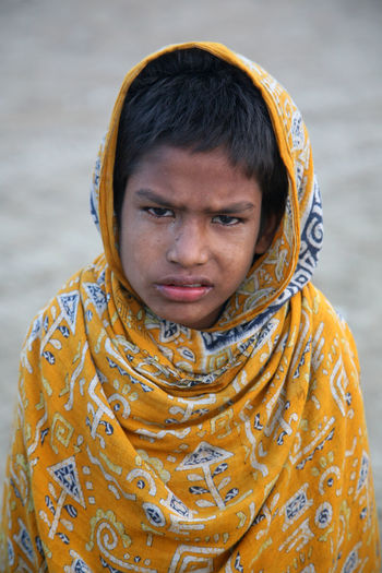 Portrait of boy on street on January 14, 2009 in Kumrokhali, West Bengal, India. ASIA Beggar Boy Child Desperate Dirty Helpless Homeless Hopeless Hunger Hungry India Juvenile Kid Kumrokhali Little Looking At Camera Miserable Person Poor  Portrait Poverty Sad Slum West Bengal