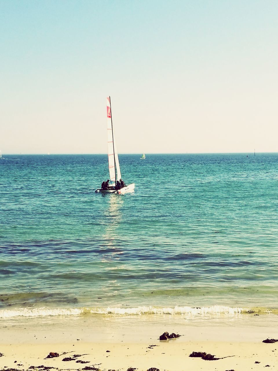 sea, horizon over water, water, beach, clear sky, sand, shore, nature, scenics, beauty in nature, outdoors, tranquil scene, tranquility, day, sky, no people, nautical vessel