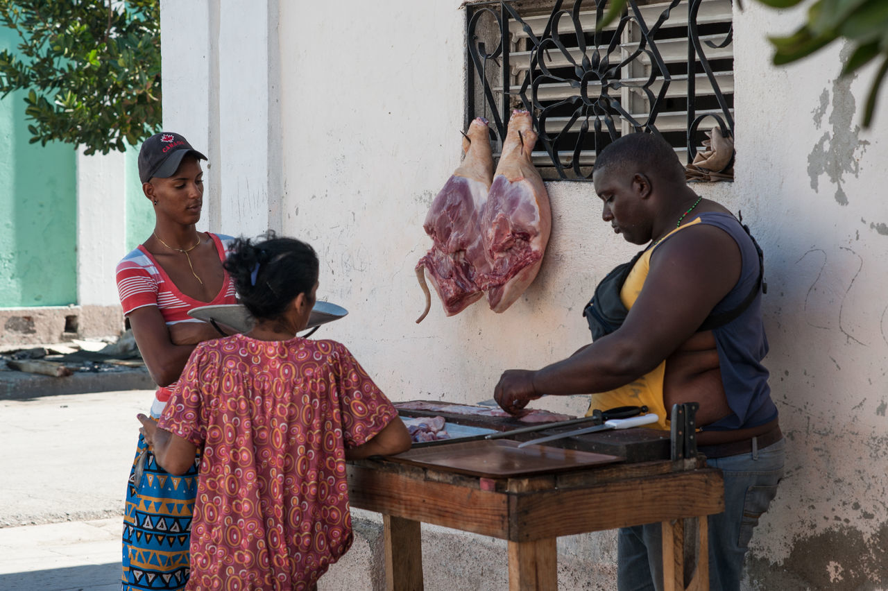 The Butcher Butcher Candid Candid Photography Cuba Day Leisure Activity Lifestyles Meat Outdoors People Profession Real People Streetcandid Streetphotography Togetherness