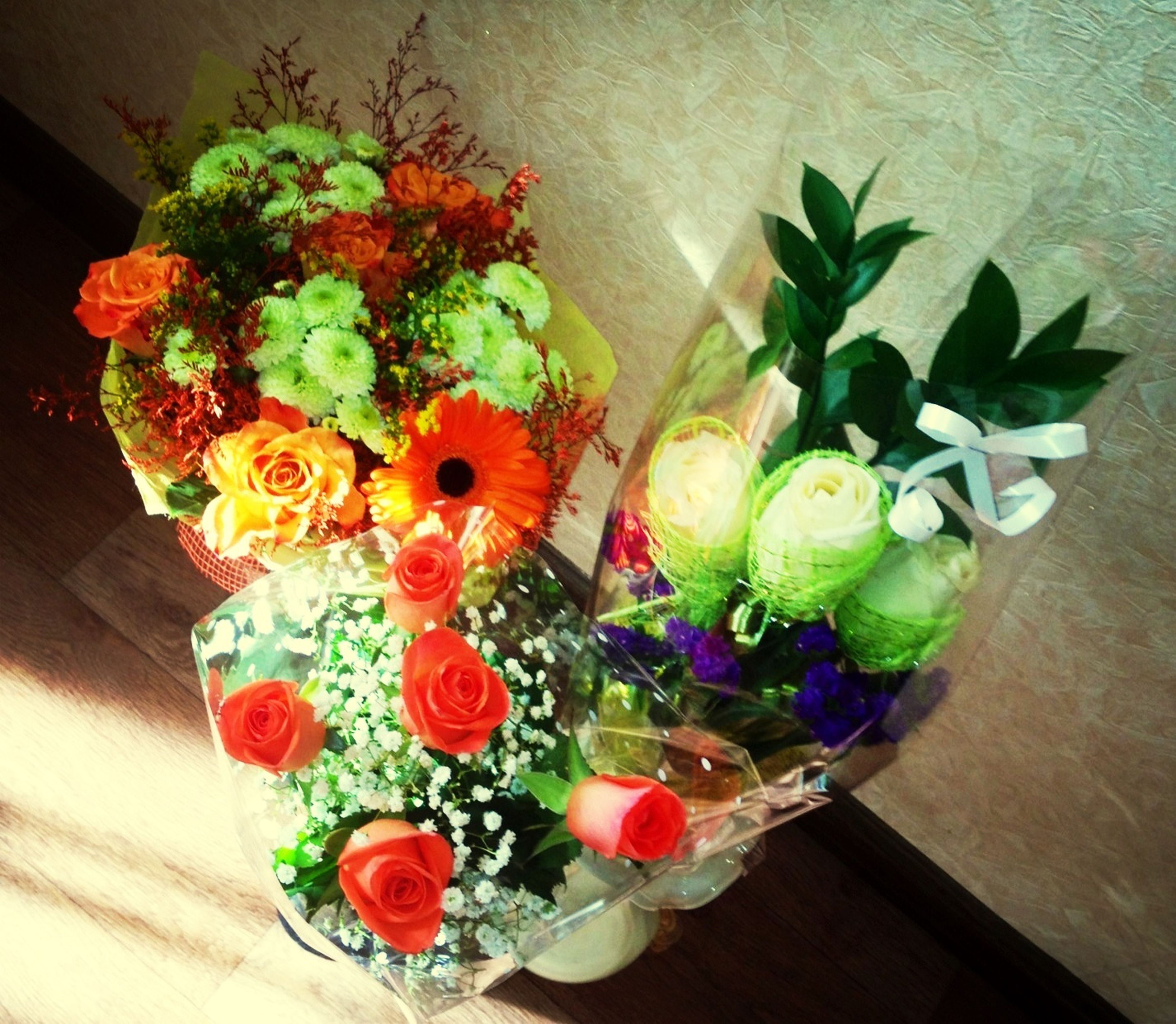 indoors, flower, table, vase, decoration, multi colored, freshness, still life, high angle view, home interior, flower arrangement, variation, bouquet, fragility, potted plant, wall - building feature, wood - material, no people, bunch of flowers, petal