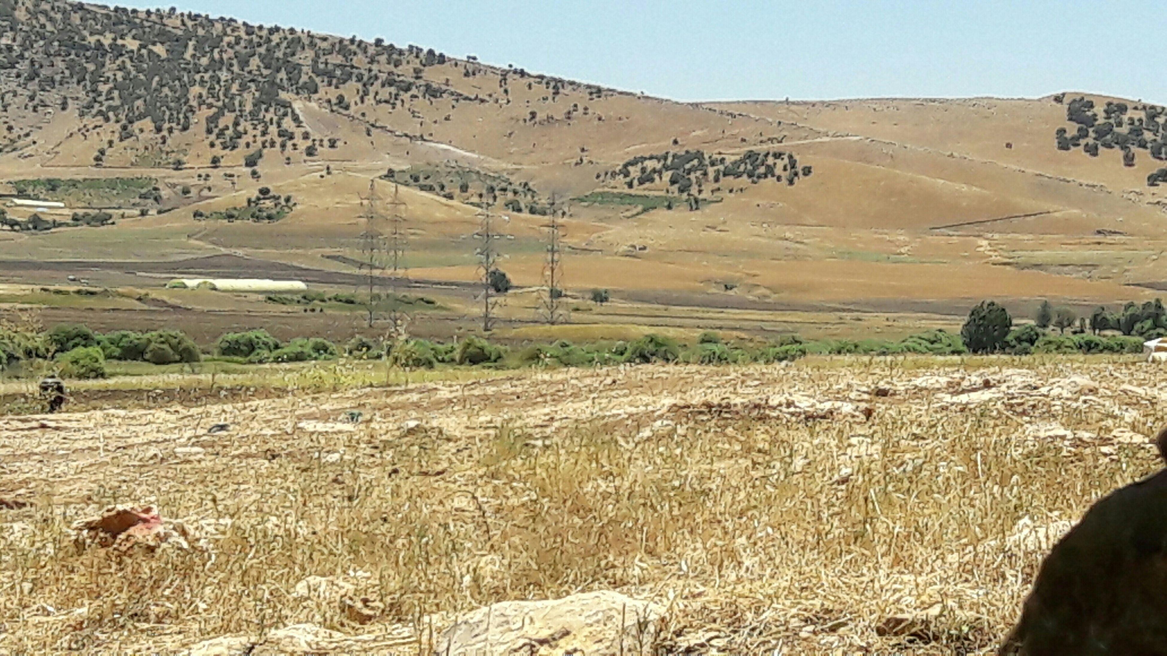 landscape, desert, tranquil scene, tranquility, arid climate, clear sky, nature, scenics, non-urban scene, mountain, remote, beauty in nature, barren, sky, field, sunlight, day, horizon over land, sand dune, sand
