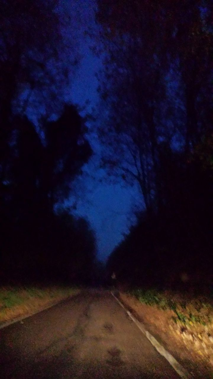 View Of Illuminated Country Road At Night