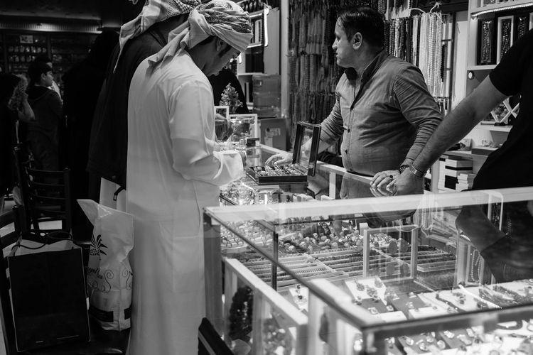 Gold bargains in the Souks Barter Traditional Trade Market Stall Souks Souk Arabs Food Men Occupation