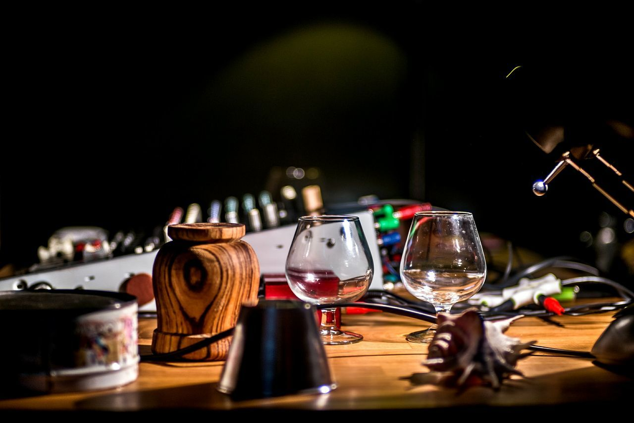 table, wineglass, indoors, large group of objects, drinking glass, plate, no people, close-up, night