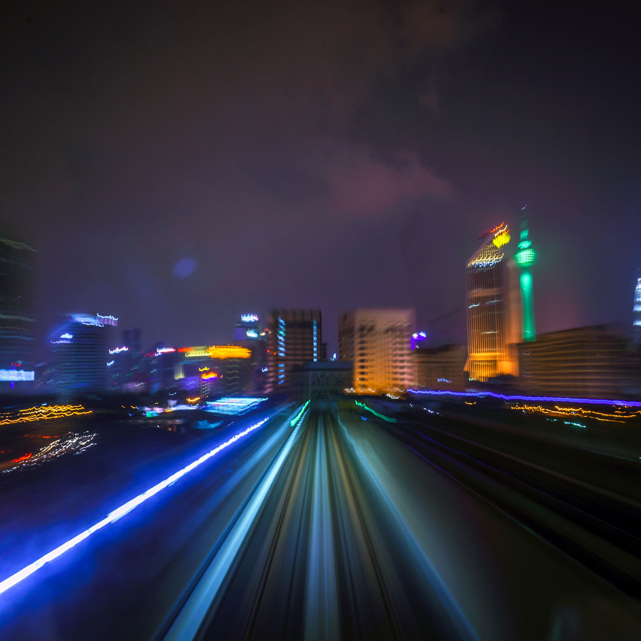 Architecture Blurred Motion Building Exterior Built Structure City City Life Cityscape High Street Illuminated Light Trail Long Exposure Modern Motion Night No People Outdoors Sky Skyscraper Speed Transportation Travel Destinations Urban Skyline Neon Life