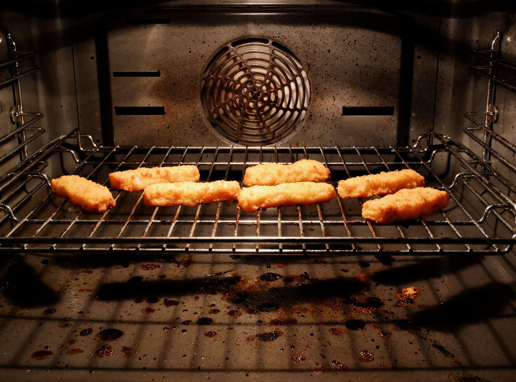 Baking fish fingers Baked Fish Close-up First Eyeem Photo Fischstäbchen Fish Fish Fingers Food Food And Drink Grilled Metal Grate No People Oven Seafood
