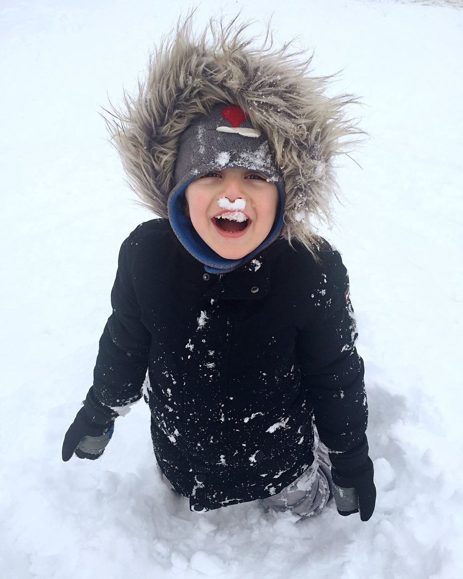 Snow Sports Winter Snow Cold Temperature Childhood Weather Child Studio Shot One Person Real People Mouth Open White Background Happiness Fur Hat Outdoors Day Human Body Part People