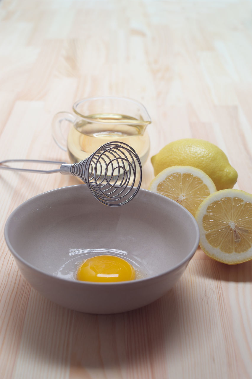 High Angle View Of Egg In Bowl On Table