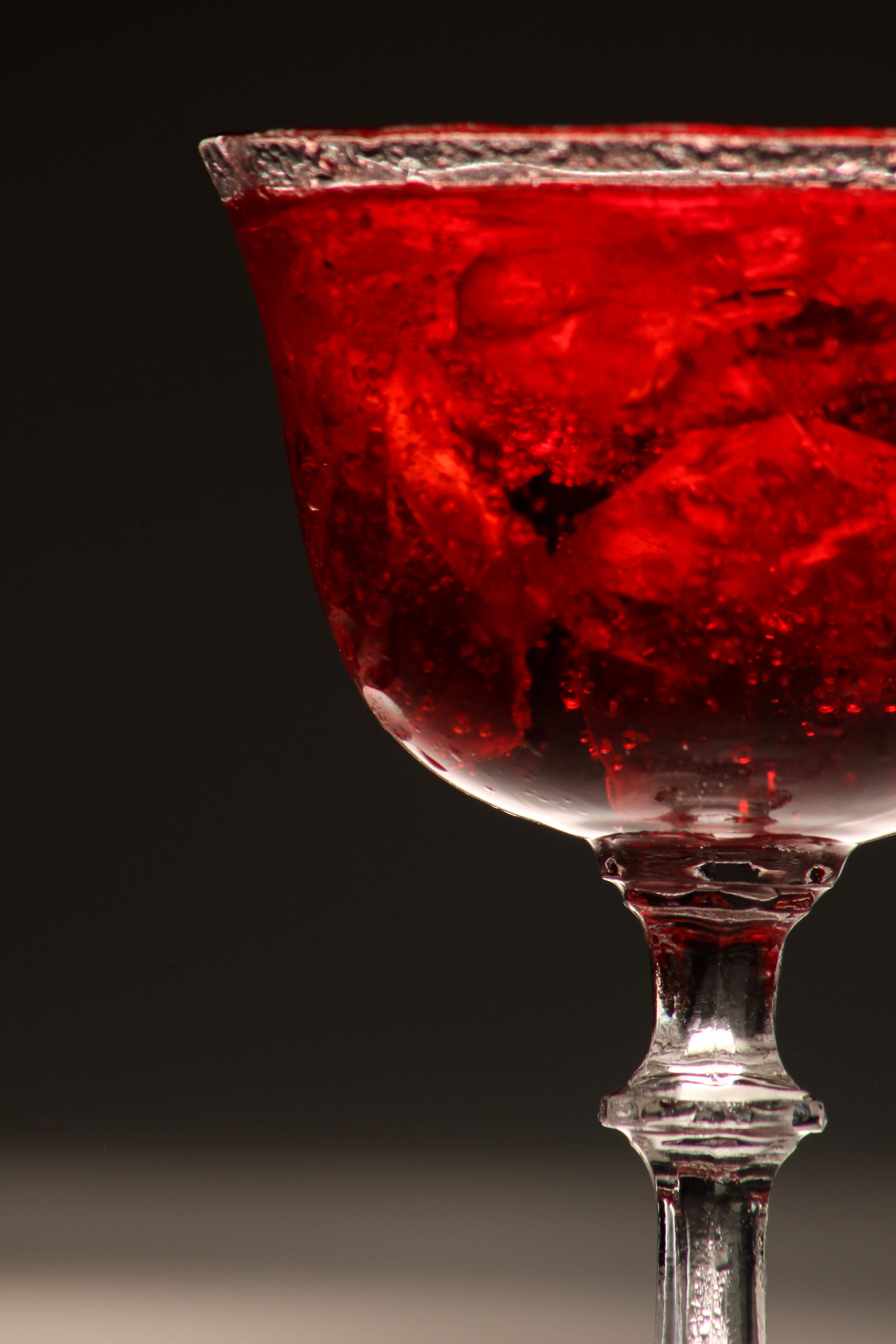 red, close-up, food and drink, refreshment, lighting equipment, studio shot, illuminated, black background, freshness, electric light, lit, no people
