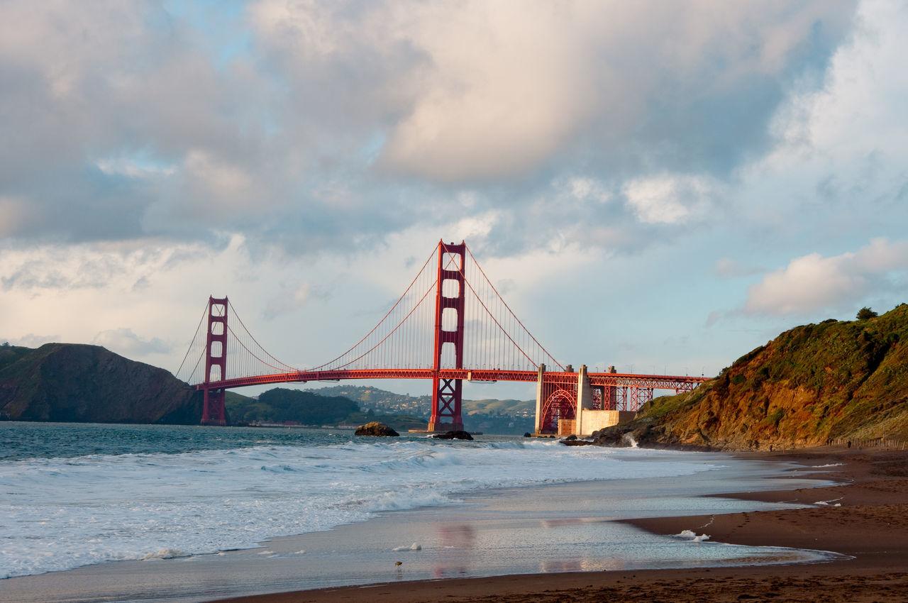 Golden Gate Bridge over San Francisco Bay against cloudy sky