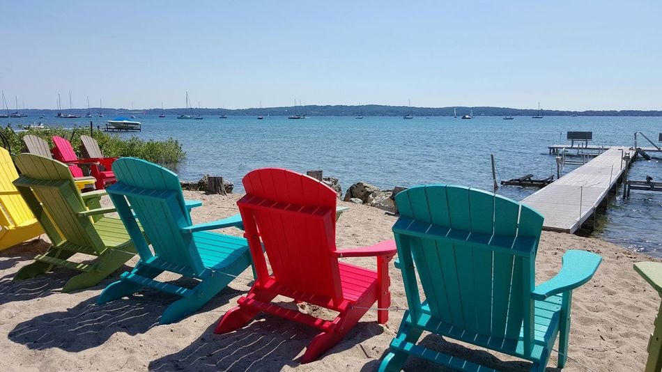 Chairs Lakeshore Sailboats Harbor Scenic Nautical Summer Daylight Sun Slow Living Relaxing Tranquil Scene Michigan