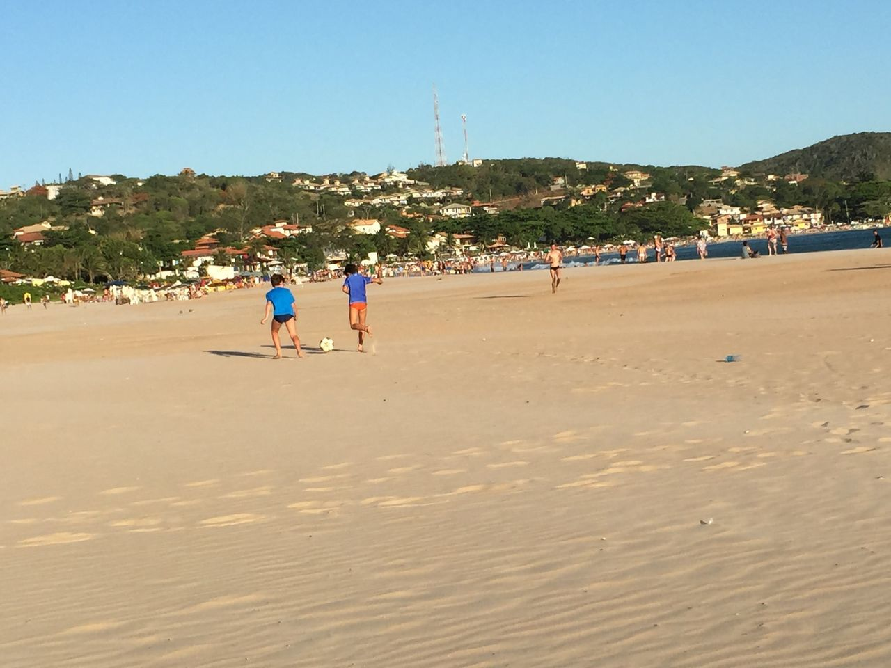 Children Playing Football On Beach