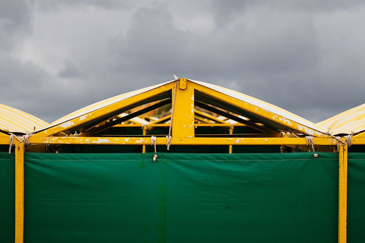 Tents At Beach Against Sky