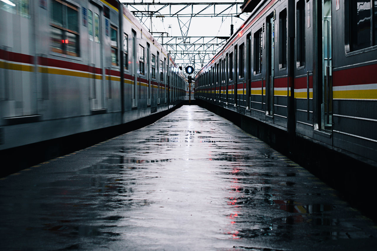 After Rain Architecture Built_Structure City City Life Commute Day Drizzle Intersection No People Outdoors Public Transportation Rain Train Train - Vehicle Train Station Train Station Platform Transportation Let's Go. Together.
