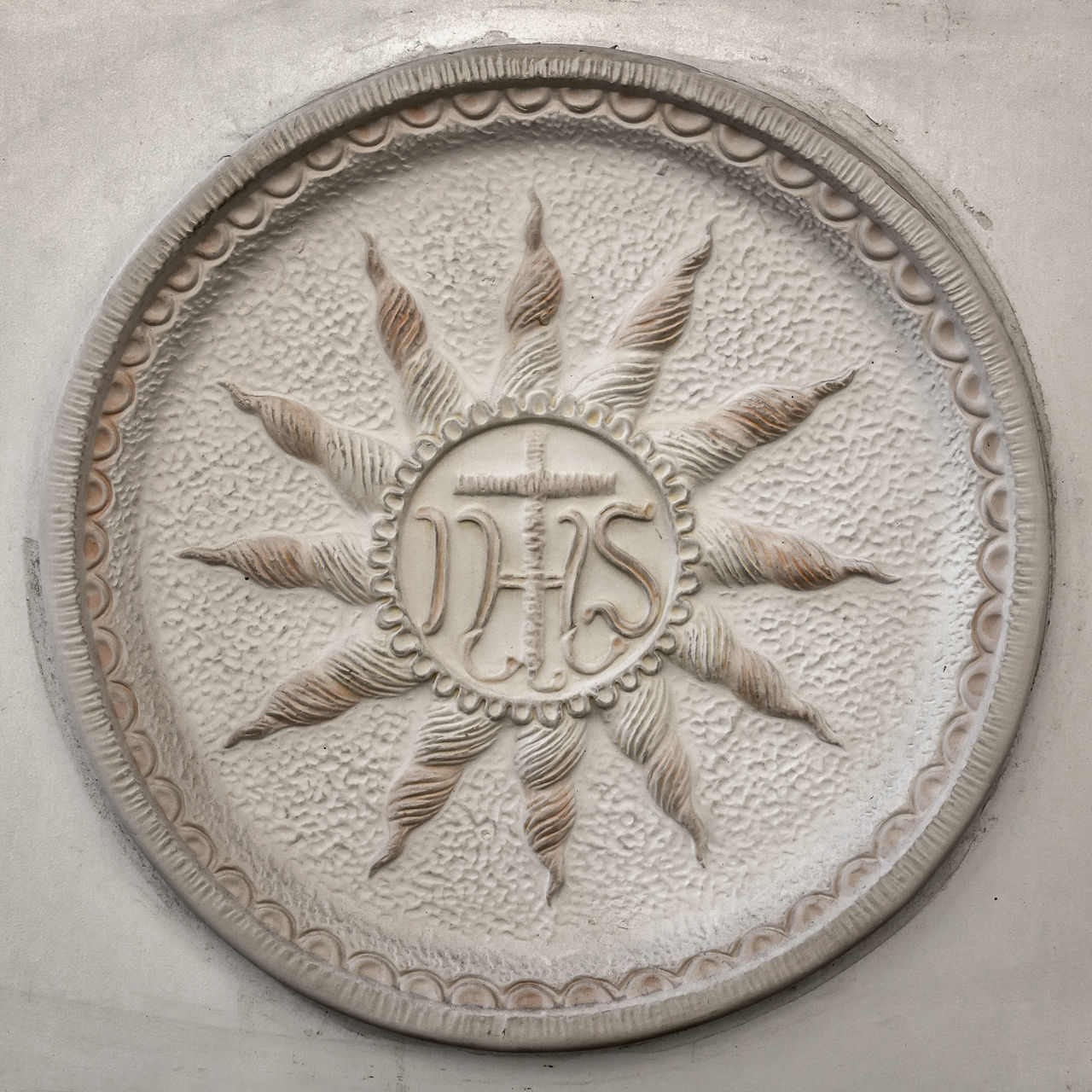 Old IHS sign (Christogram) sculpted above stone door Adore Belief Bible Carved Catholic Christ Christian Christianity Church Close-up Cross Cult Faith Holy Hope Icon Jesus Love Middle Monogram Monument Old Protection Religion Religious