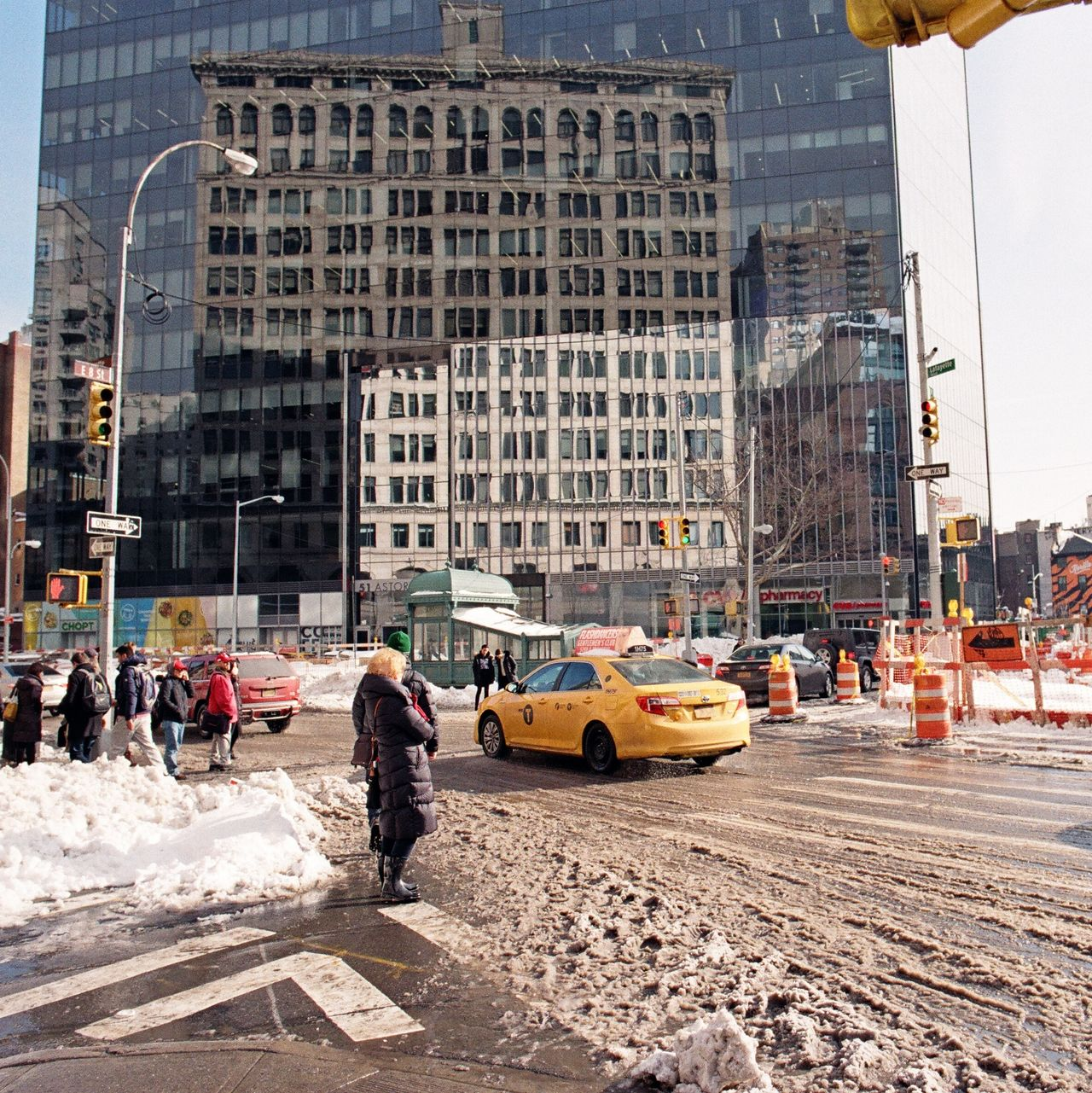 East Village, January 2016 City City Street Yellow Taxi Yellow Cab Nyctaxi Snow Reflection On Building Lomography Color Negative 100 35mm Film Film Photography Ishootfilm Elan7 Street Photography Streetphotography Streetphoto_color