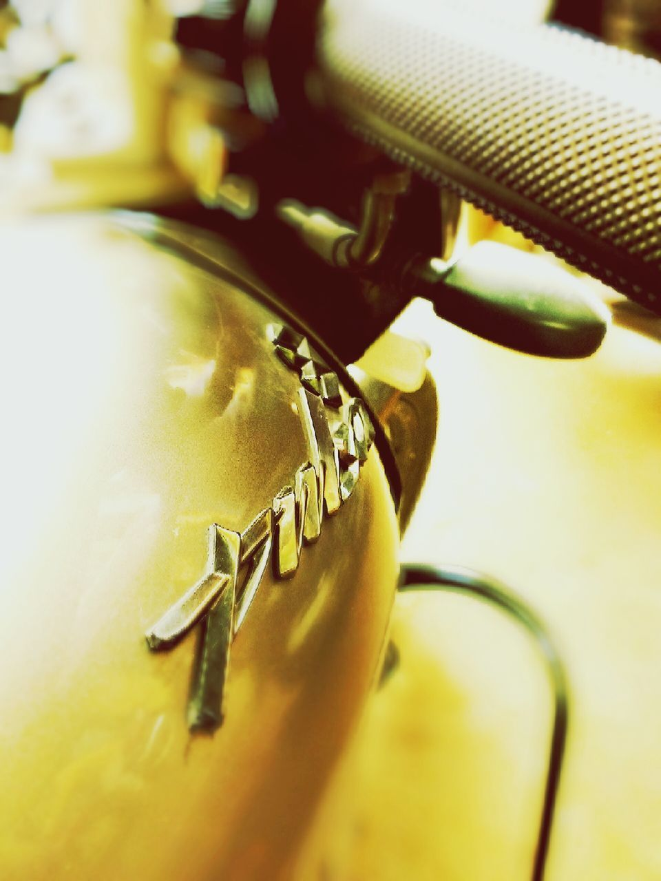 selective focus, close-up, metal, no people, indoors, machinery, gold colored, technology, gear, day