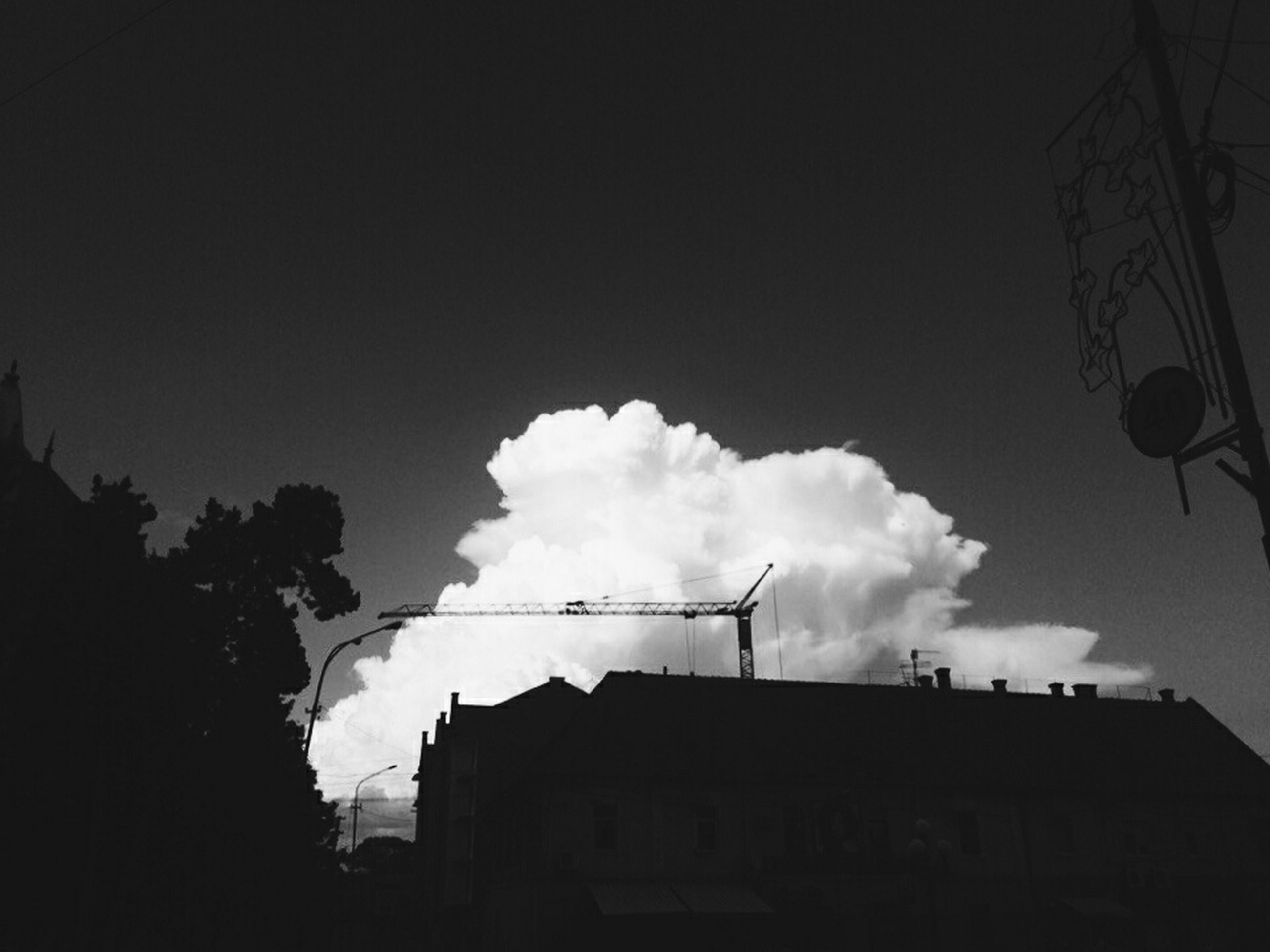 building exterior, architecture, built structure, low angle view, sky, building, cloud - sky, residential structure, residential building, house, city, high section, silhouette, cloudy, outdoors, cloud, no people, dusk, day, weather